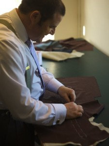 Bespoke tailors yorkshire. This shows me hand basting the canvas onto one side of the coat fronts.