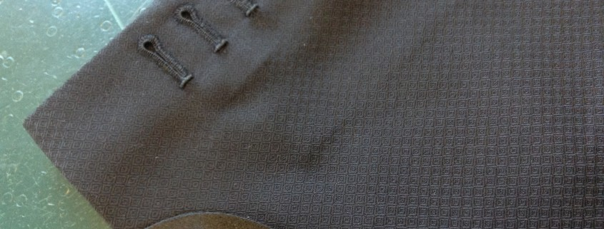 hand-made button holes. Four real hand made button holes, and a pure silk gauntlet cuff.
