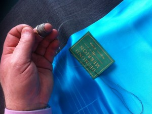 Me hand stitching my label into a clients made to measure suit